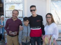 Refugees, visitors experience huge differences between Greek camps
